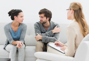 Young couple in meeting with a financial adviser at home